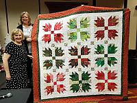 Quilt by Melinda Seegers and the winner of the quilt